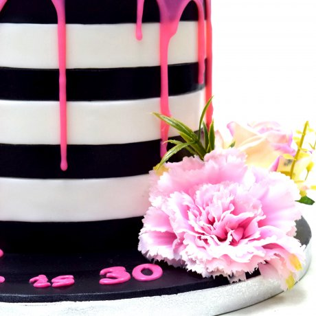 Black and White Stripes and pink dripping Cake