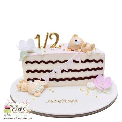 Half birthday cake with teddy bears