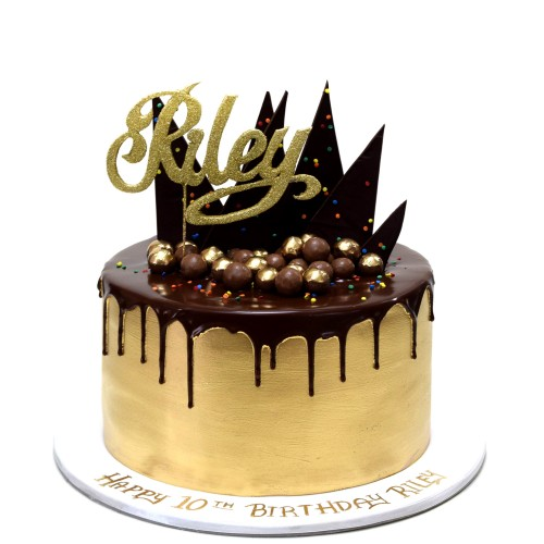 gold cake with chocolate drip and cake topper 7