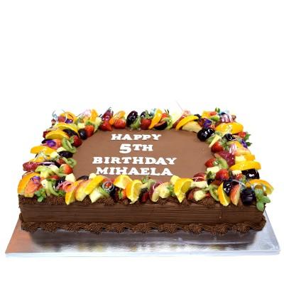 Chocolate cream and fruits cake