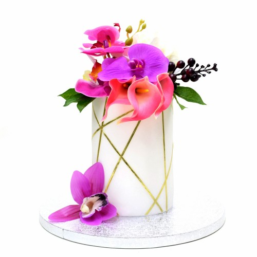 Tall trendy cake with flowers