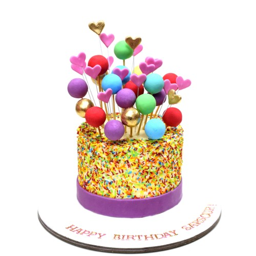 cake with rainbow vermicelli balls and hearts 7
