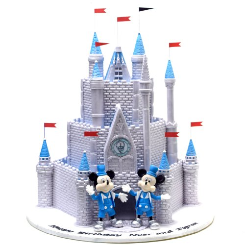 Disneyland Paris castle cake with Mickey and Minnie Mouse