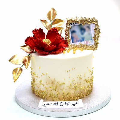 Cake with red flower, gold accents and photo frame
