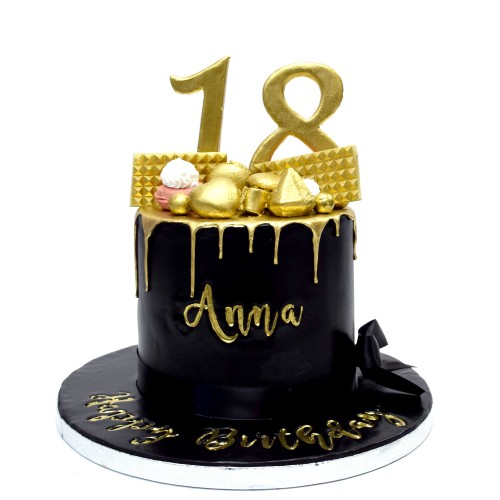 black cake with gold drip 7
