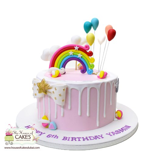 Cake with rainbow and balloons