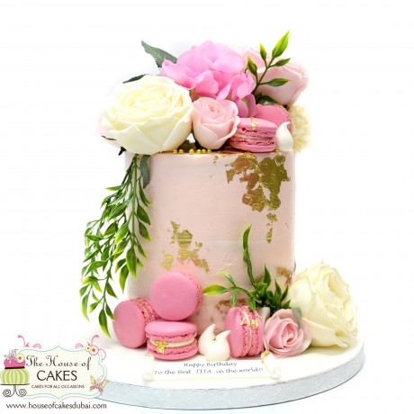 semi naked pink buttercream cake with flowers and gold details 6