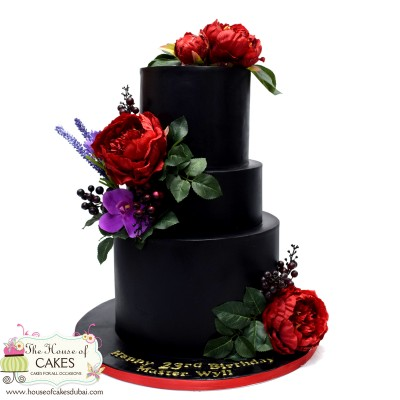 Black cake with red peonies
