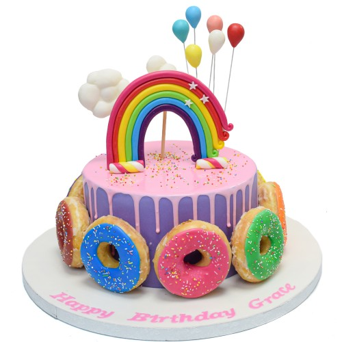 Cake with doughnuts and rainbow
