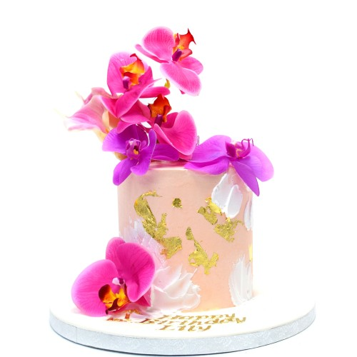 Cake with orchids and gold accents