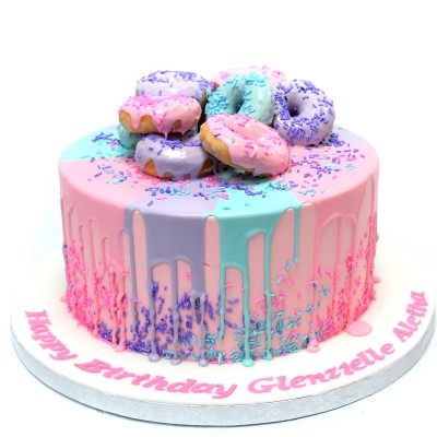 Cake with colourful doughnuts