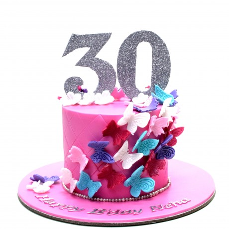 pink cake with colourful butterflies 6