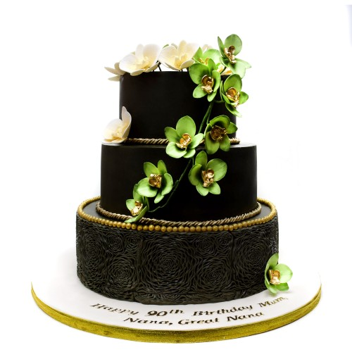 Black cake with green flowers