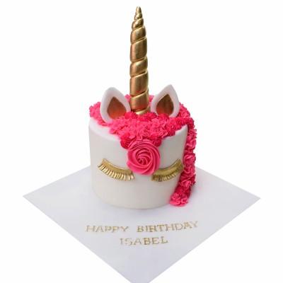 Unicorn cake with gold lashes