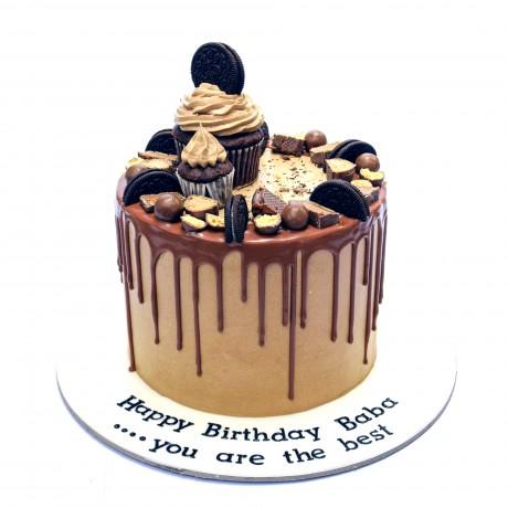cream cake with cupcake and oreo's 6