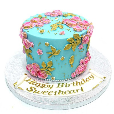 Blue cake with pink flowers