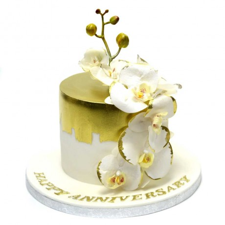white and gold cake with orchids 12
