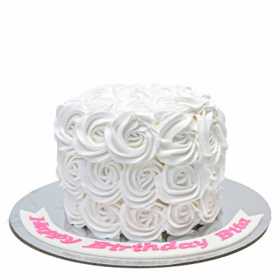 White rosettes cake with cream