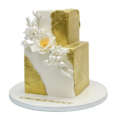 Modern trendy gold and white cake