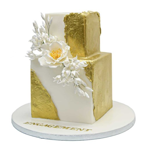 modern trendy gold and white cake 7
