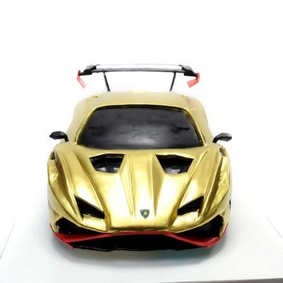 Gold Lamborghini car cake