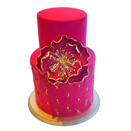 gold and bright pink cake with flowers 12