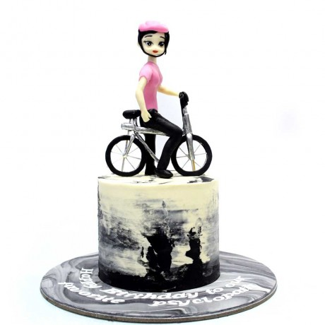 lady with bicycle cake 6
