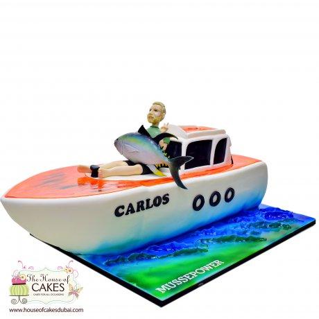 Fisherman on boat cake