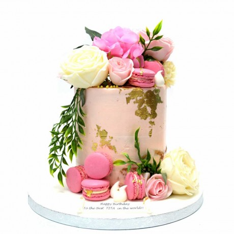 pink buttercream cake with flowers and gold details 12