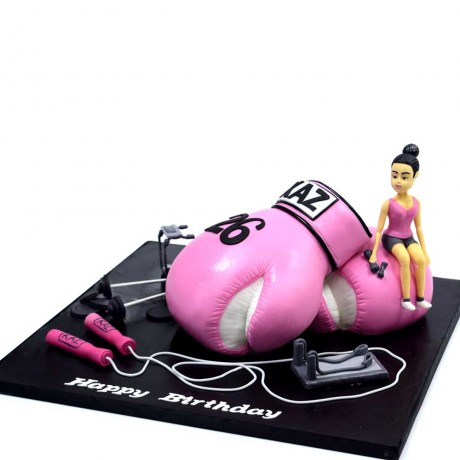 Boxing glove, lady and fitness cake