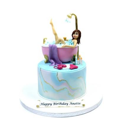 Pretty lady in bath tub cake