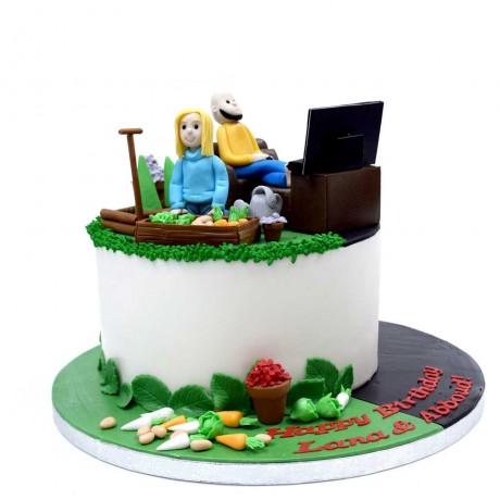 she is gardening he is watching tv cake 6