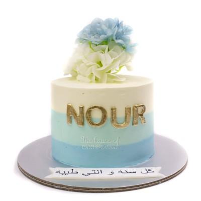 Pretty white and blue cake