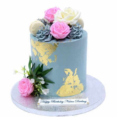 Grey and gold cake with flowers