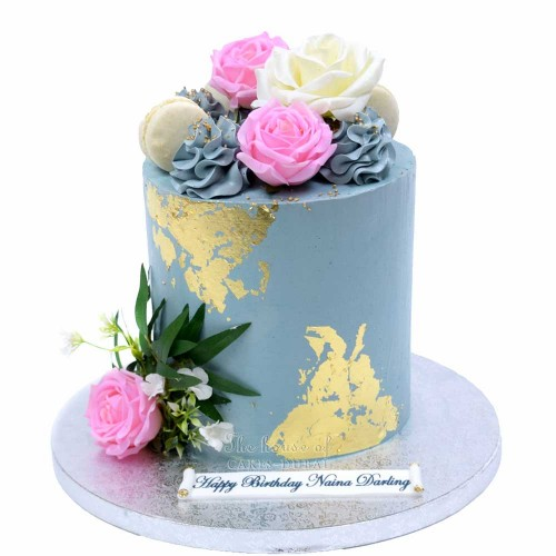 grey and gold cake with flowers 13