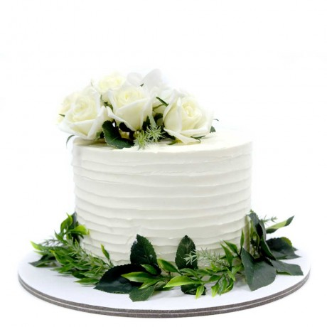 white cream cake with green leaves and white roses 6