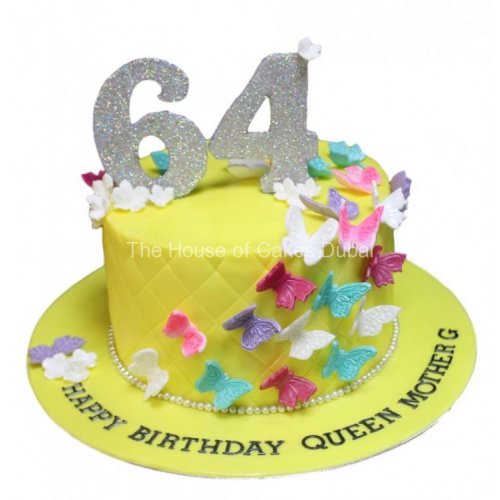 Yellow cake with colorful butterflies