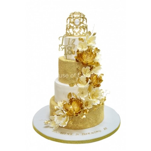 gold and white cake with crown 7