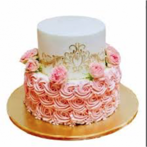 Cake with cream swirls and gold lace