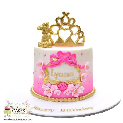 Pretty white and pink cake with crown