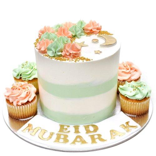 Pastel cream cake and cupcakes
