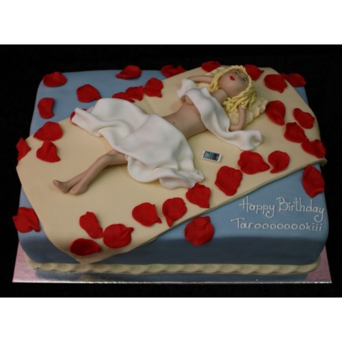 Bed with rose petals cake