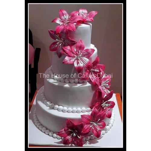 Wedding Cake with fuschia flowers