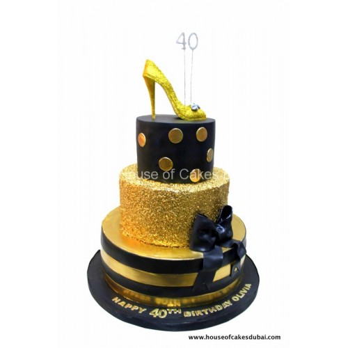 elegant cake in black with gold sequins and golden shoe 7