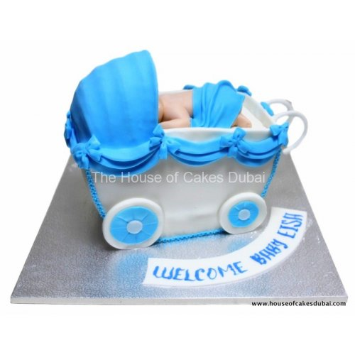 Baby in carriage cake