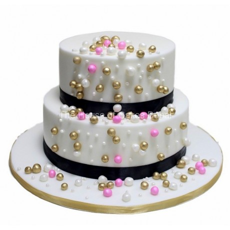 cake with pink, gold and white balls 6