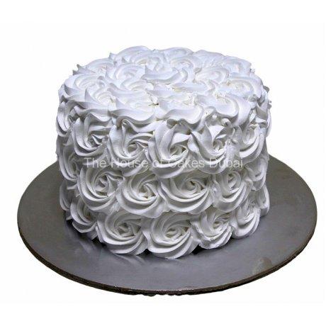 white rosettes cake with cream 6