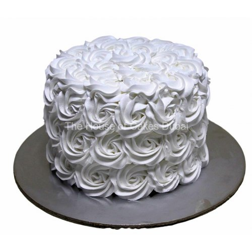 White rosettes cake with cream