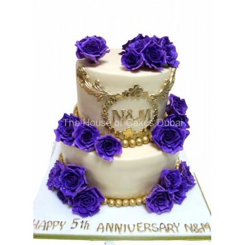 Golden cake with purple roses