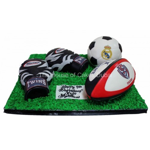 Boxing, rugby and football cake
